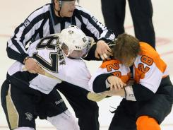 Philadelphia Flyers center Claude Giroux and Pittsburgh Penguins center Sidney Crosby fight during the first period Sunday.