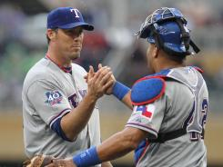 Joe Nathan, left, is 3-for-4 in save chances with his new team, including Sunday's against his former team.