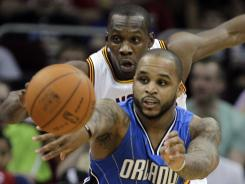 Magic point guard Jameer Nelson passes away from Cavaliers forward Lester Hudson in the second quarter of their game Sunday. Nelson led the Magic with a 21-point effort.