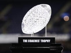 AFCA Coaches Trophy that features a Waterford Crystal football is valued at approximately $30,000.