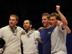U.S. team members, left to right, Seth Kelsey, Ben Bratton, Cody Mattern and Soren Thompson celebrate their first-place win in the men's team epee competition at the 2012 World Fencing Championships in Kiev on April 14.