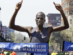 Wesley Korir of Kenya crosses the finish line to win the men's division of the Boston Marathon in Boston.