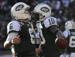 Will the arrival of Tim Tebow help or hinder Jets like QB Mark Sanchez (6) and WR Santonio Holmes?