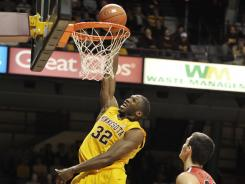 In this Nov. 17, 2011, photo, Minnesota's Trevor Mbakwe (32) dunks during an NCAA college basketball game against Fairfield in Minneapolis. Mbakwe was granted a sixth season of eligibility and will return to the Gophers this season.