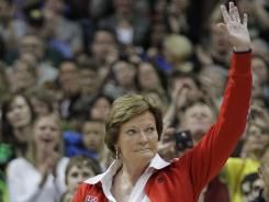 Tennessee coach Pat Summitt waves to the crowd during a halftime ceremony to honor past Olympic coaches at the women's Final Four.
