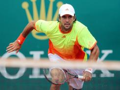 Fernando Verdasco of Spain heads to the net during his victory Monday against Olivier Rochus of Belgium during the Monte Carlo Masters.