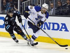 St. Louis defenseman Carlo Colaiacovo, skating with the puck past Sharks right wing Tommy Wingels (57), tallied three assists in the Blues' 4-3 win.