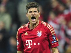 Bayern Munich's striker Mario Gomez reacts during the UEFA Champions League first-leg semifinal match against Real Madrid in Munich, Germany on Tuesday. Bayern Munich handed Real Madrid its first loss in the match.