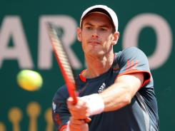 Andy Murray of Britain powers a backhand during his easy win Tuesday against Viktor Troicki of Serbia at the Monte Carlo Masters.