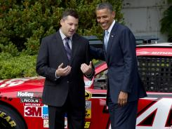 President Obama, right, talks with 2011 Sprint Cup champion Tony Stewart Tuesday at the White House. Stewart was one of four NASCAR drivers to decline the previous invitation from the president.