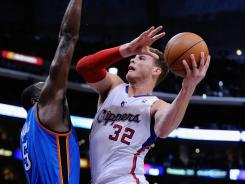 Clippers forward Blake Griffin drives to the hoop against Thunder forward Serge Ibaka during the second quarter. Griffin had 17 points in the win for Los Angeles.