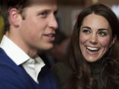 Britain's Prince William, Duke of Cambridge and his wife Kate, Duchess of Cambridge, attend a reception during a visit to Centrepoint's Camberwell Foyer in London on Dec. 21, 2011.