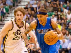 Utah Jazz forward Gordon Hayward, left, and Dallas Maverick guard Delonte West, right, had different reactions to the 'wet willie' incident in Monday's triple overtime win by the Jazz.