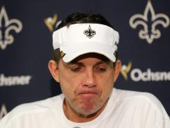 The NFL has ruled that Saints coach Sean Payton (above) and general manager Mickey Loomis cannot speak with each other or league officials while suspended.