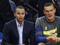 Golden State Warriors guard Stephen Curry, left, has been troubled by injuries all season.
