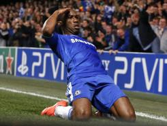 Didier Drogba celebrates his first-half tally that lifted Chelsea over Barcelona, his 38th career Champions League goal.
