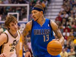 Dallas Mavericks guard Delonte West, right, was fined $25,000 for his finger poke of Utah Jazz forward Gordon Hayward, left, in Utah's triple-overtime win Monday.