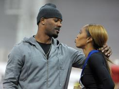 Aaron Ross kisses wife Sanya Richards-Ross after she won the womens 400-meter in 50.71 seconds in the 2012 USA Indoor Championships.