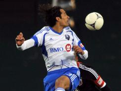 Bernardo Corradi scored his second goal of the season in the 69th minute to help Montreal draw with D.C. United.