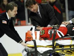 Blackhawks right wing Marian Hossa is taken off the ice on a stretcher after getting an elbow from Coyotes left wing Raffi Torres.