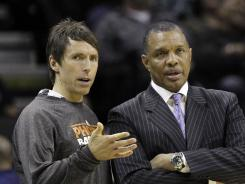 Veteran Phoenix point guard Steve Nash wants to play for a contender before he retires and is OK about leaving coach Alvin Gentry, right, and the Suns as a free agent after the season.