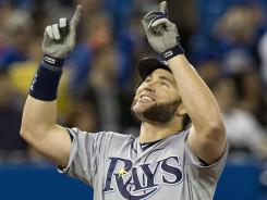Rays designated hitter Luke Scott celebrates his grand slam off Blue Jays pitcher Carlos Villanueva during the ninth inning. Tampa won 12-2.