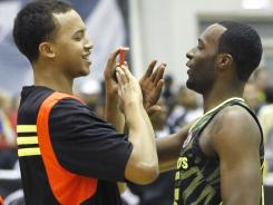 Future UCLA teammates Kyle Anderson, left, and Shabazz Muhammad celebrate Muhammad's victory last month in the dunk competition prior to the McDonald's All American Game