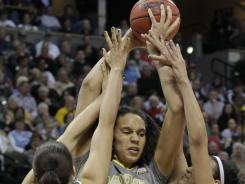 Brittney Griner's towering 6-8 presence led Baylor to a record-setting 40-0 season and a national title this month.