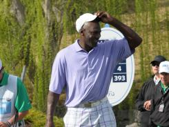 Michael Jordan can't be happy with the play of his Charlotte Bobcats but put on a good show at the Michael Jordan Celebrity Invitational golf tournament in Las Vegas in March.