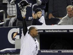 Curtis Granderson takes a curtain call after one of his home runs Thursday at Yankee Stadium.