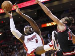 LeBron James (6) had 27 points and 11 rebounds to lead the Heat to their fifth straight win.