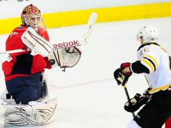 Washington Capitals goalie Braden Holtby makes a save in the first period on a shot by Boston Bruins center David Krejci.