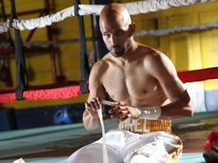 Eric Morel removes tape from his hands after a workout recently in preparation for his title fight Saturday against Abner Mares.