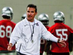 Ohio State coach Urban Meyer directs his team during the first day of their spring college football practice back in March.