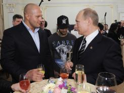 Fedor Emeliananko, left, has been a longtime supporter of Vladimir Putin, prime minister of Russia. Emelianenko spoke with him in Moscow on March 5, the day after Putin won Russia's presidential election.