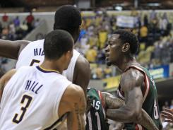 The Milwaukee Bucks' Larry Sanders, right, is held by teammate Monta Ellis during an altercation in the second half of the Bucks' 118-109 win over the Pacers on Thursday. Sanders was ejected after receiving his second technical foul.