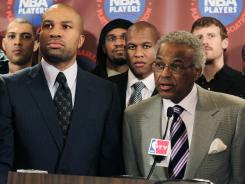 After calling for an audit of the union's finances, NBPA president Derek Fisher, left, suffered a stinging rebuke from executive director Billy Hunter and the rest of the executive committee.