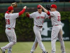 Reds outfielders Chris Heisey, left, Drew Stubbs, center and Jay Bruce celebrate after defeating the Cubs.