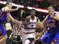 The Cleveland Cavaliers' Manny Harris (6) drives between New York Knicks' Steve Novak (16) and Josh Harrellson (55) in the fourth quarter of the Cavs' win over the Knicks. Harris had 19 points and 12 rebounds.