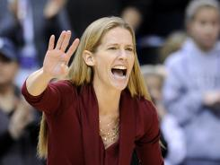 St. John's coach Kim Barnes-Arico gestures to her team during the first half of a game vs. Connecticut in March.