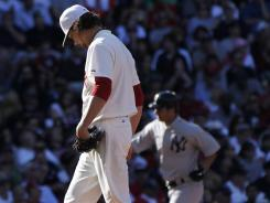 Clay Buchholz, left, can only hang his head as Eric Chavez rounds the bases after hitting one of the Yankees' five home runs.
