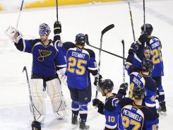 St. Louis Blues players wave to fans after the completion of Game 5 against the San Jose Sharks. The club won its first playoff series in a decade in ousting the Sharks.