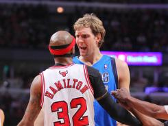 Dallas Mavericks power forward Dirk Nowitzki (41) and Chicago Bulls shooting guard Richard Hamilton (32) have a heated discussion during the second half at the United Center. The Bulls won 93-83.