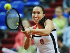 Jelena Jankovic of Serbia lines up a backhand during her opening victory Saturday against Anastasia Pavlyuchenkova of Russia in their Fed Cup semifinal in Moscow.