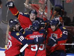 Panthers right wing Scottie Upshall, center, celebrates his goal against the Devils during the third period of Game 5 at the BankAtlantic Center in Sunrise, Fla. The Panthers won 3-0.