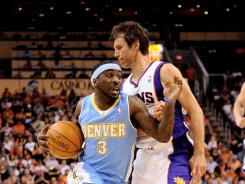 Denver Nuggets guard Ty Lawson (3) drives the ball against the Phoenix Suns guard Steve Nash (13) during the Nuggets' 118-107 win over the Suns on Saturday.