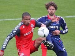 Toronto FC forward Ryan Johnson (9) battles for the ball against Chicago Fire defender Arne Friedrich (23) at BMO Field. The Fire beat the FC 3-2 and Toronto is still winless after six games.