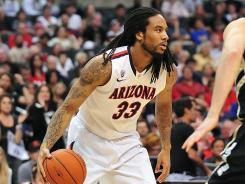 Arizona Wildcats forward Jesse Perry, shown here playing in the Pac 12 tournament in March, was arrested Friday on a felony domestic violence charge.