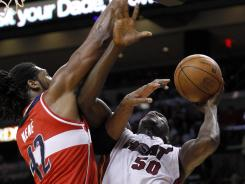 Washington's Nene (42) prepares to block a shot by Miami Joel Anthony (50) in the first half of the Wizards' win over the Heat on Saturday.
