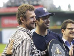 Brewers' Ryan Braun, center, poses with his MVP trophy and Brewers Hall-of-Famer Robin Yount, left, during a pregame ceremony.